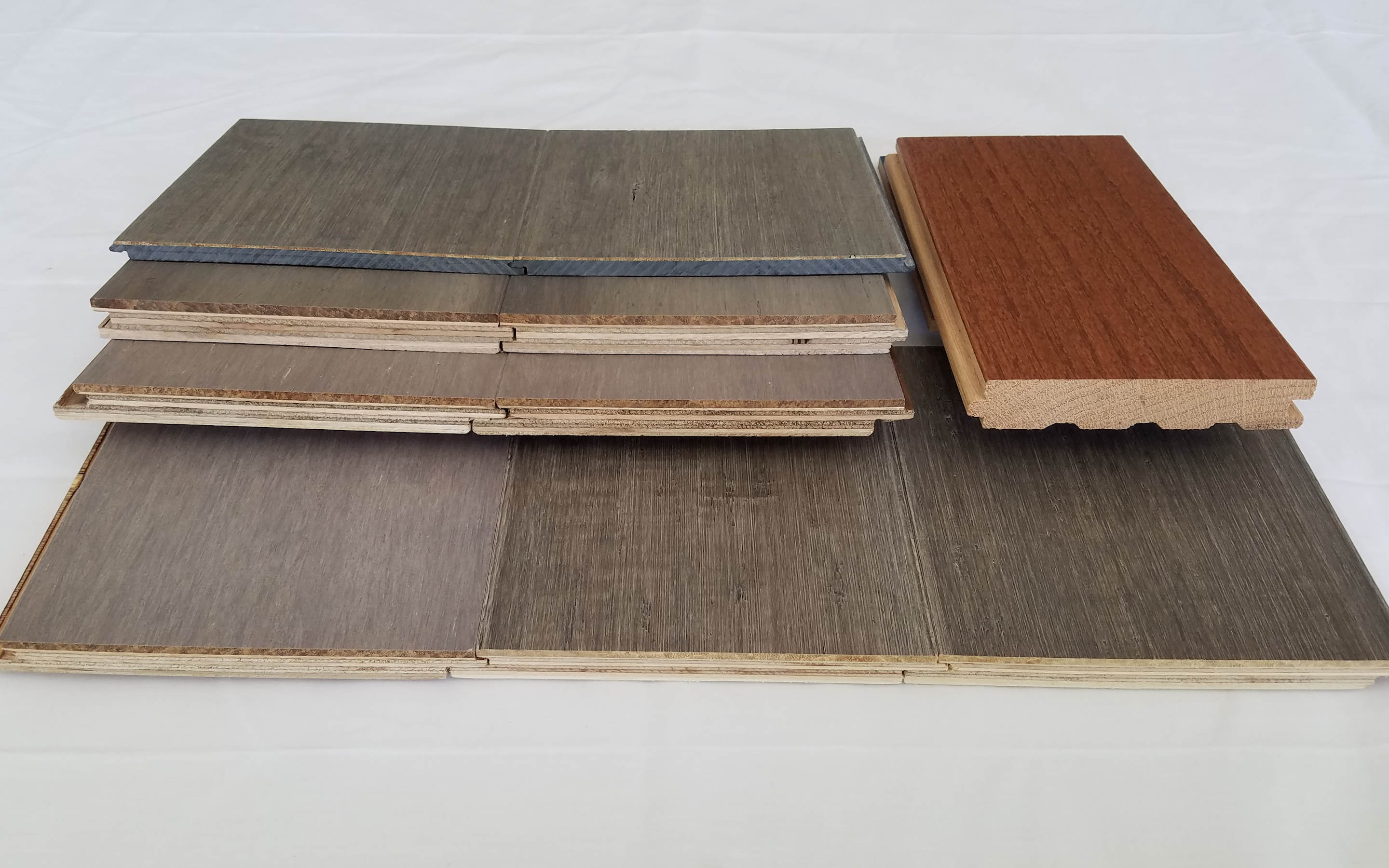 edge samples of engineered wood and hardwood flooring